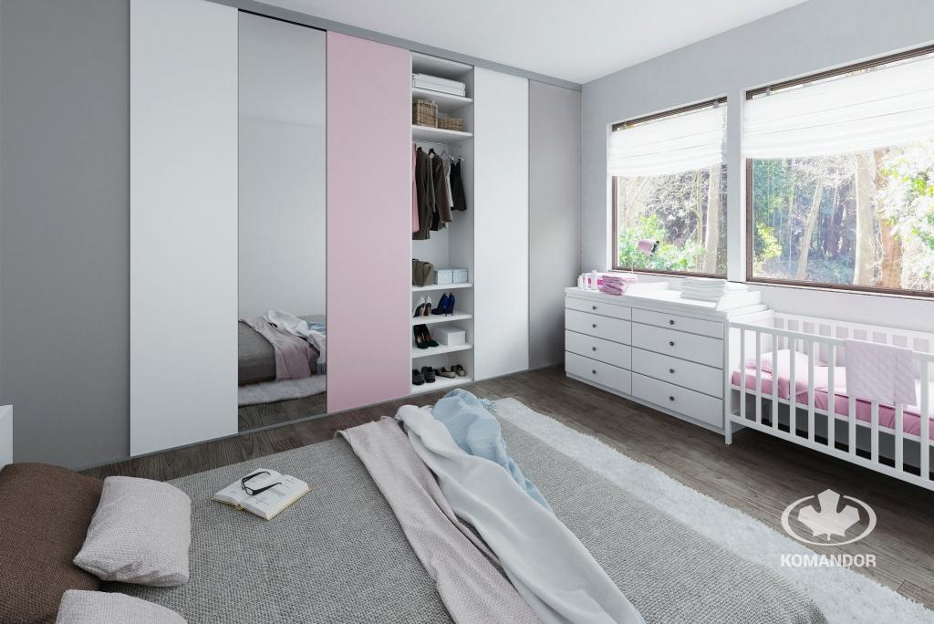 Pastelowe kolory na froncie szafy uspokajają wnętrze - trend Pastelowa Świeżość w aranżacji sypialni Komandor